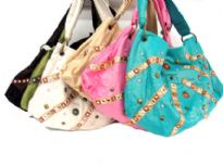 Stone Studded fabric handbag with single shoulder handle in same material