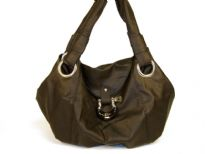 Soft PVC handbag with double shoulder handle & flap like closure on the top.