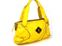 Designer Inspired PU Handbag with broad double shoulder straps & artistic trim design in the front. Top zipper closure.