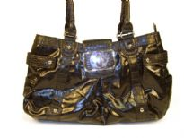 Designer Inspired Handbag has an animal print pattern along straps and shiny leather like texture. Bag has a top zipper closure and belt flap with a twist lock closure. Bag has a double handle. Made of PU (polyurethane).