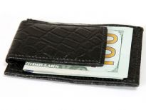 Carry your money in style. This is a Genuine Leather magnetic Money clip, credit card holder. As this is genuine leather, please be aware that there will be some small creases and nicks in the leather but the wallet are all brand new.