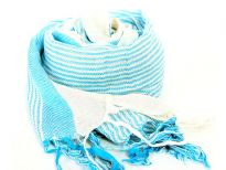 This bright turquoise colored viscose scarf with off-white combination can lighten up any mood or outfit. Loose threads like fringe at its edges. Imported.