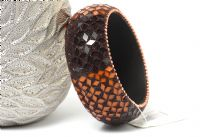 Beautiful wide cuff fashion bangle has small mirrors in brown & orange making a floral pattern all over the bangle. Made of Resin and is very lightweight.