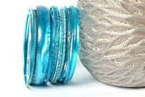 This 14 piece set of hand crafted bangles have skinny as well as wide cuff bangles in resin material. Each bangle has its own etched design or is plain & simple. Lightweight & stylish set of fashion bangles can be matched with lot of outfits.