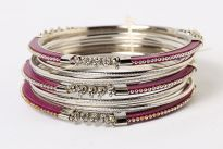 Beautifully hand crafted 9 pieces set of stylish bangles includes 3 purple colored resin bangles encrusted in silver colored metal frame & 6 skinny bangles either etched or plain. Rich color of these bangles makes them attractive & reflects expertise to craft them.