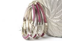 Beautifully hand crafted 9 pieces set of stylish bangles includes 3 purple colored resin bangles encrusted in silver colored metal frame & 6 skinny bangles either etched or plain. Rich color of these bangles makes them attractive & reflects expertise to craft them. Fits small to medium size wrist.