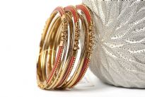 Beautifully hand crafted 9 pieces set of stylish bangles includes 3 rust colored resin bangles encrusted in gold colored metal frame & 6 skinny bangles either etched or plain. Rich color of these bangles makes them attractive.