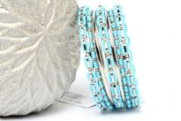 Turquoise Beads Silver Metal Fashion Bangles Set can add zing to any kind of outfit. Set includes 4 thin bangles, 2 petal patterned with beads and 3 bangles having beads in boxy shape. Durable & long lasting quality.