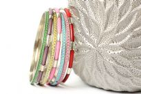 This is a 7 piece set of bangle bracelets in assorted colors. Handcrafted by expect artisans in India.