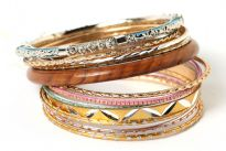 Colorful & Fashionable set of 13 Pieces includes a wooden bangle, a turquoise metal bangle with floral metal design & glittery thin bangles in resin material. Hand crafted & very lightweight.