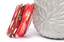 This assorted bangles set in coral color has 12 pieces including 1 resin bangle in bronze colored metal frame, 1 broad resin bangle & 10 thin resin bangles in different patterns. Can be worn all together as a set or individually. Hand crafted.