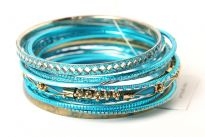 This is a 15 pieces set of hand crafted bangle bracelets. The Turquoise/Gold colored set features unique and assorted styled bangles. Fits small/medium sized wrist.