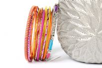 Bohemian fashion 13 piece set of bangle bracelets. Handcrafted by expert artisans in India. Durable and high quality bangle set.