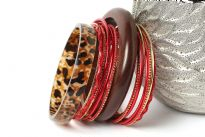 This fashion bangles set includes 16 pieces in total with 2 wide wooden bangles & 14 thin bangles. Thin bangles are plain as well as glittered. Ethnic as well as trendy look & can be matched with any kind of outfit.