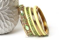 Chunky looking assortment of 10 pieces  including 4 thin bangles, 3 lime green resin bangles, 2 thin green bangles & one wide metal pattern bangle with green rhinestones on it. This set can light up any outfit.