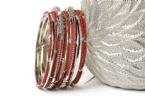 Elegant looking silver metal fashion bangles set of 12 pieces has small rust beads on 7 thin bangles, 3 thin silver bangles & 2 are resin bangles encrusted in silver metal frame.