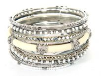 Beautiful & trendy 8 pieces fashion bangles set has white beads 3 thin bangles, 2 mirror pattern bangles, 2 metal patterned bangles & one ivory resin bangle inside a metal frame. This bangle set can be matched with any kind of casual or formal outfit.