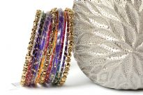 This colorful fashion bangles set of 11 pieces includes 3 metal floral pattern bangles, 2 broad purple resin bangles & 6 shaded thin bangles.