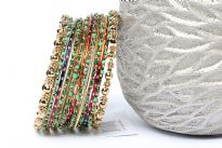 Bohemian Gold Metal Fashion Bangles Set in assorted designs. Set includes 2 metal floral pattern bangles, 6 wavy pattern bangles with green beads, 3 thin multi colored bangles & 2 thin gold bangles. Colorful set can be matched with number of outfits & are very lightweight.