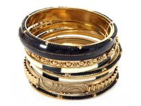 Very beautiful & trendy 11 pieces set includes one wide black bangle, one metal patterned bangle, 2 painted bangles, 3 thin gold colored bangles, 3 thin black beads bangles & 1 floral pattern bangle. Hand crafted in India.