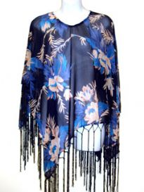 Blue Floral Print Rayon Poncho in Navy color with long hanging fringes along its border. Imported.