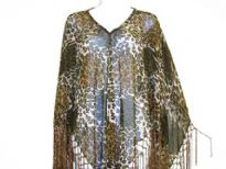 Leopard print v-neck poncho is made of sheer rayon material. Hanging fringes on its border in satin thread material. Imported.