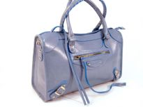 Rina Rich PU Handbag. Top zipper closing.