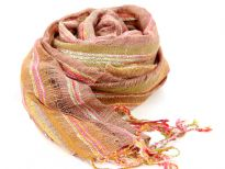 Mocha colored open weave 100% viscose scarf with tones of orange & pink. Twisted long fringes on the edges completes this pastel scarf. Imported. Hand wash.