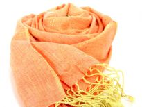 95% viscose with 5% metallic scarf in shades of orange and yellow. Thin metallic gold stripes run through it horizontally. Imported. Hand wash.