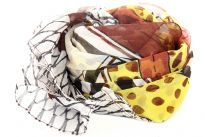 Beige colored sheer scarf has artistic print of semi circles, dots & stripes in brown, yellow, mustard colors. Brown colored border along its vertical length & criss-cross stripes along its width. 100% polyester scarf. Imported.