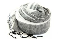 Vertical Stripes in different sizes pattern over this 100% linen scarf which is little stiff & semi-sheer. Black color is woven into white & twisted fringes on the ends of the scarf. Imported.
