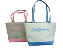 Fashionable California bag has a double shoulder straps and a top zipper closure. Made of fabric.