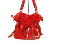 PVC Crocodile embossed handbag. Top zipper closing.