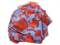 This periwinkle blue 100% silk scarf has garden inspired print in red. Very lightweight & soft to use. Made in India.