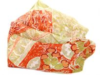 Beautiful print in apple green & red on beige colored 100% silk scarf. Lightweight & very soft to use. Made in India.