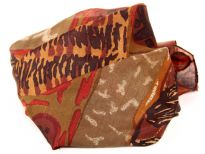 Abstract print 100% silk scarf in shades of brown, red & orange. Square scarf is both lightweight & easy to use. Made in India.