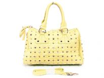 Faur Leather Metal Eyelets studded double handle bag. Top zipper closing, adjustable shoulder strap included.