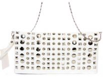 Faux leather folding clutch studded with rhinestones. Top zipper closing. Back outside zipper pocket. Wrist strap and metal shoulder chain included.