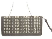 Faux leather folding studded clutch bag. zipper closing. Back outside zipper pocket. Wrist strap and metal shoulder chain included.