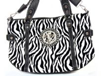 Animal Print Fleur De Liz Handbag with double shoulder handle as well as removable long shoulder strap. Top zipper closing.