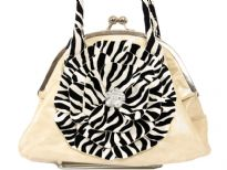 Shining PVC Handbag with zebra print double handle & cut out flower applique at front. Kiss lock closure of the bag. Imported.